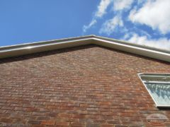 Cement mortar repointing with new bargeboard and soffit