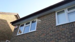 Rosewood fascia with white tongue and groove soffit