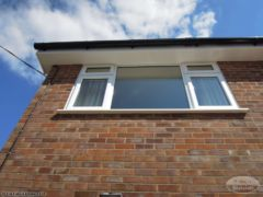 UPVC plain soffit and fascia replacement with black gutters