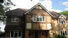 UPVC white fascias and soffits with deep flow guttering to mock Tudor property