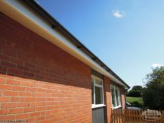White ash fascia installation with black upvc gutters