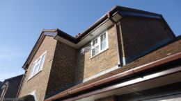 White tongue and groove soffit, rosewood fascia and brown square guttering