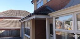 Decorative fascias with black square guttering on a porch