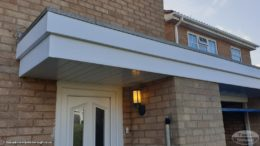 fascias and soffits on a flat roof garage and porch