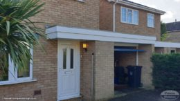 white fascias and soffits on a flat roof garage