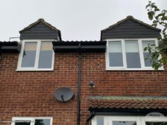 black UPVC shiplap cladding on dormer windows