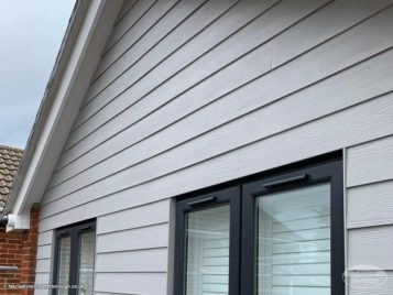 new Hardieplank cladding in pearl grey installation